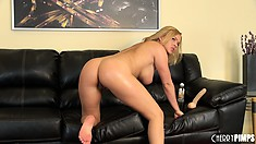 Busty blonde Krissy Lynn bends over the couch and shows off her ass
